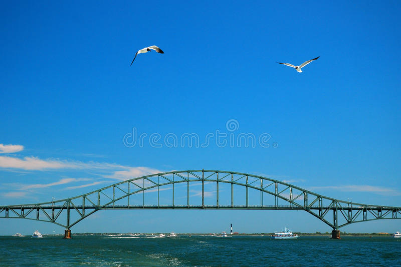 Robert Moese Causeway. The steel arch bridge carrying the Robert Moses Causeway spans the Great South Bay in Long Island royalty free stock images