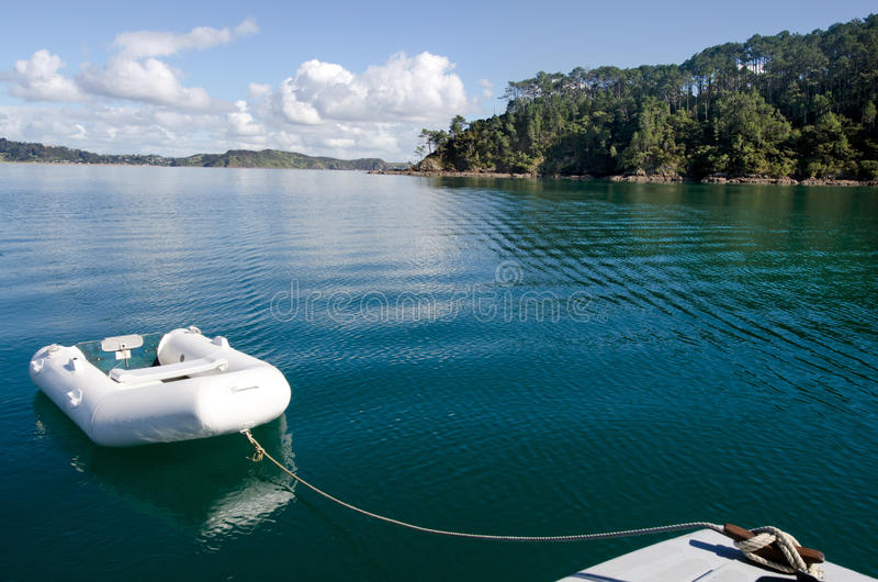 Roberton Island in the Bay of Islands New Zealand. White dingy boat mooring at Roberton Island in the Bay of Islands, New Zealand stock images