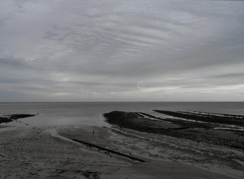 Robin Hood`s Bay panorama with overcast sky. Robin Hood`s Bay Yorkshire low tide panorama with overcast sky royalty free stock photo