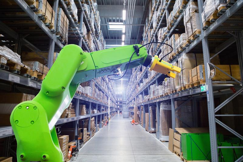 Roboric arm in warehouse. Roboric arm in a modern smart warehouse royalty free stock images