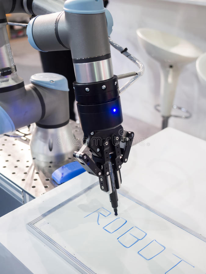 Robot arm for automatic production line stock photography