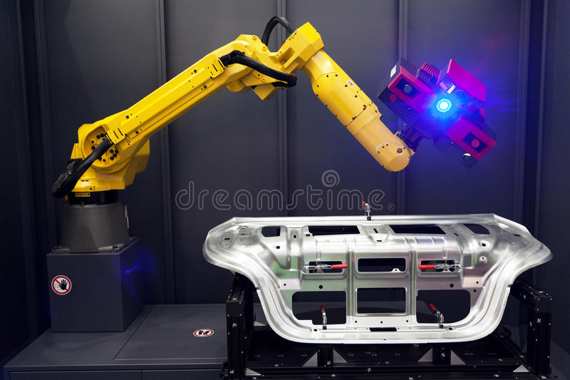 Robot arm with 3D scanner. Automated scanning. Combined 3D scanner and robotic arm automate scanning. Optical 3D coordinate measuring machine royalty free stock photo
