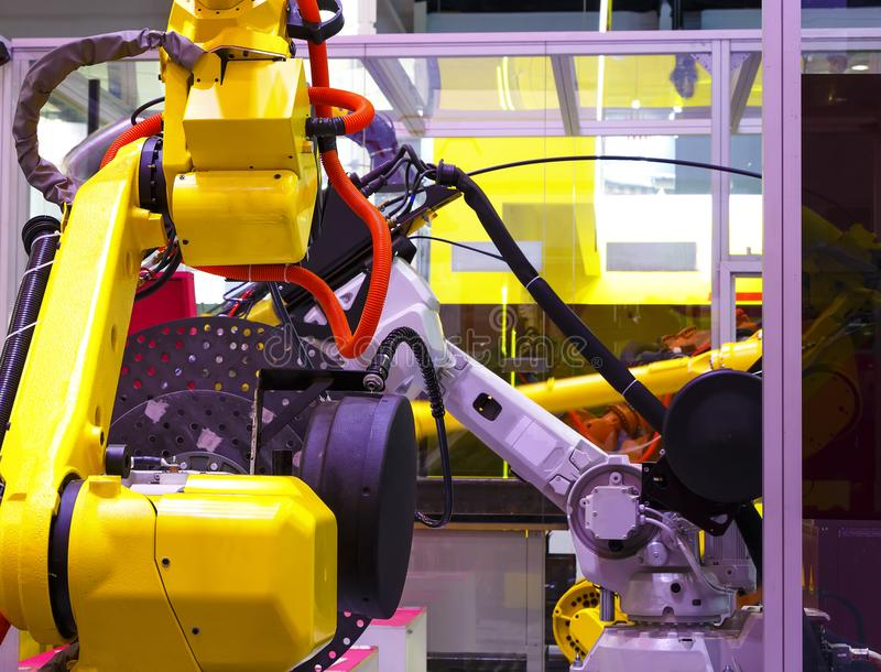 Robot arm in machine tool metalworking process for industry manufacture,CNC metal machining. royalty free stock image