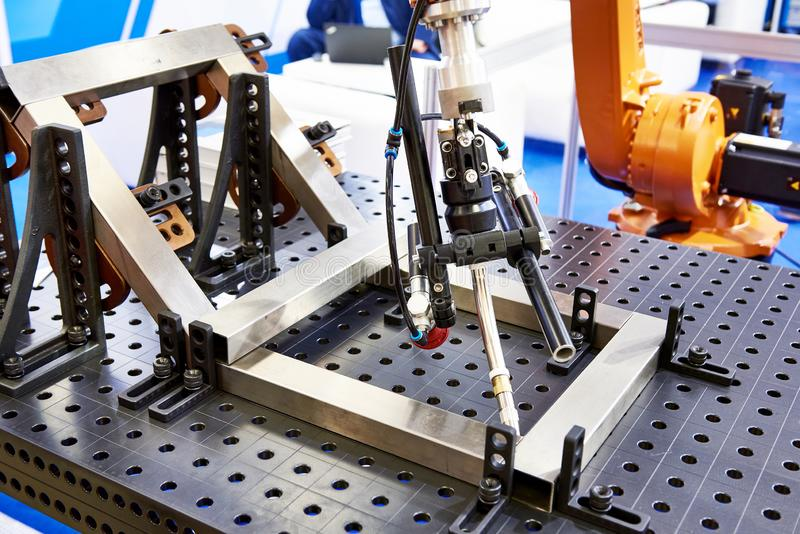 Robot arm for welding stock image