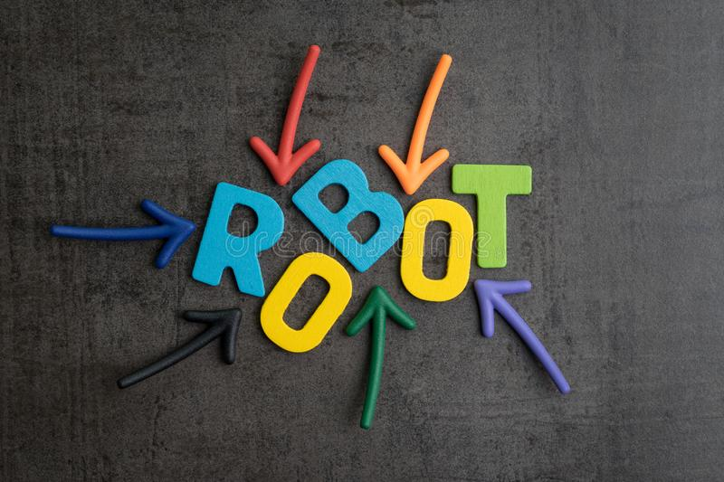 Robot or artificial intelligence concept, multiple arrow pointing to colorful alphabets building the word ROBOT on black cement stock images