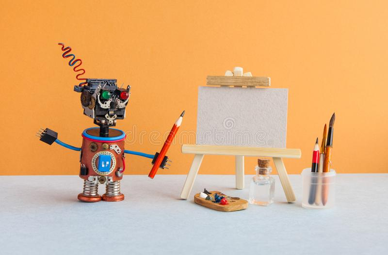 Robot artist begins to create a drawing with a pencil. White paper mockup, wooden easel and artist`s tools palette. Pencils case royalty free stock images