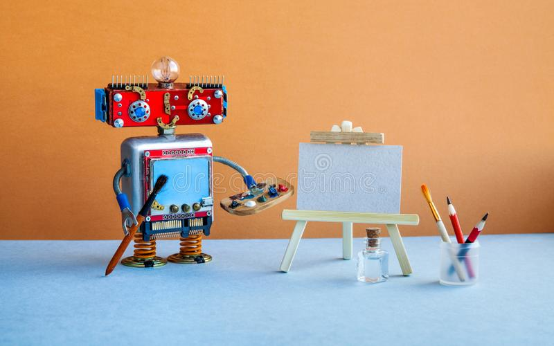 Robot artist begins to create a drawing. White paper mockup, wooden easel and artist`s tools palette, pencils case. Robot artist begins to create a drawing royalty free stock photo