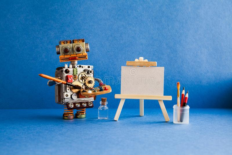 Robot artist with brush paints palette, wooden easel and blank white paper. Advertising poster studio school of visual. Arts and drawing. Blue background royalty free stock images