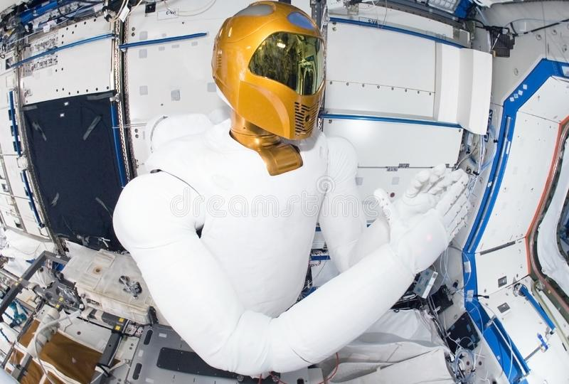 Robot astronaut on a space station.Elements of this image were furnished by NASA stock photo