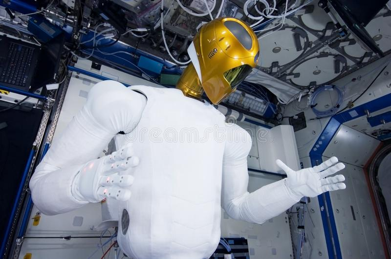 Robot astronaut on a space station.Elements of this image were furnished by NASA stock image