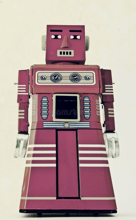 Robot. Big pink robot looking proud stock photo