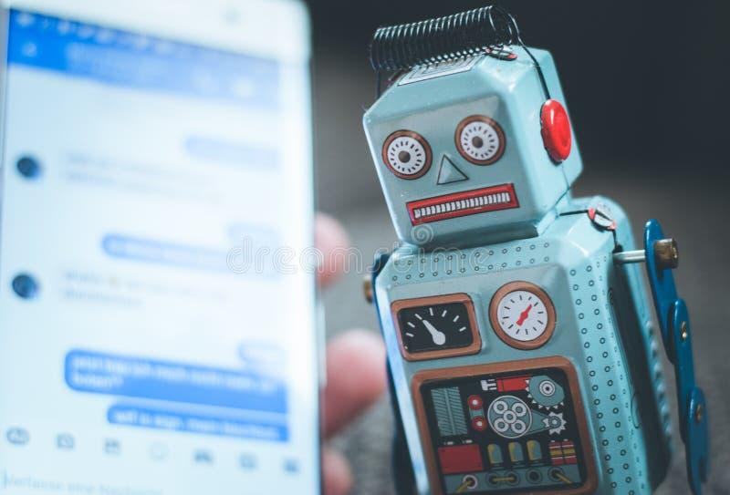Symbol for chat bot, smartphone and messenger. Robot chatbot messenger surveillance social algorithm artificial code intelligence ai data big communication royalty free stock images