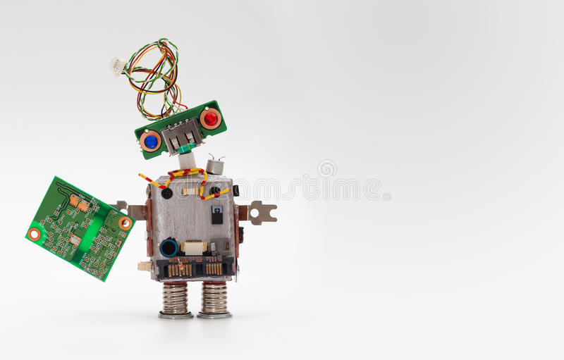 Robot with chip board. Computer accessories toy mechanism, funny head, electrical wire hairstyle, colorful blue red eyes royalty free stock photography