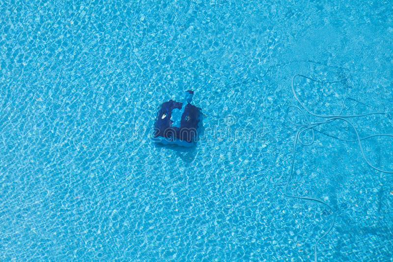 Robot cleaning a swimming pool stock photos
