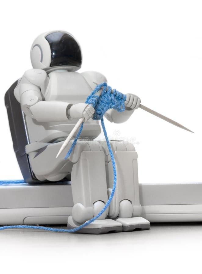 Robot de tricotage photographie stock