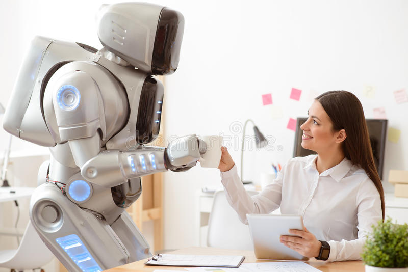 Robot giving cup of coffee to the girl royalty free stock photo