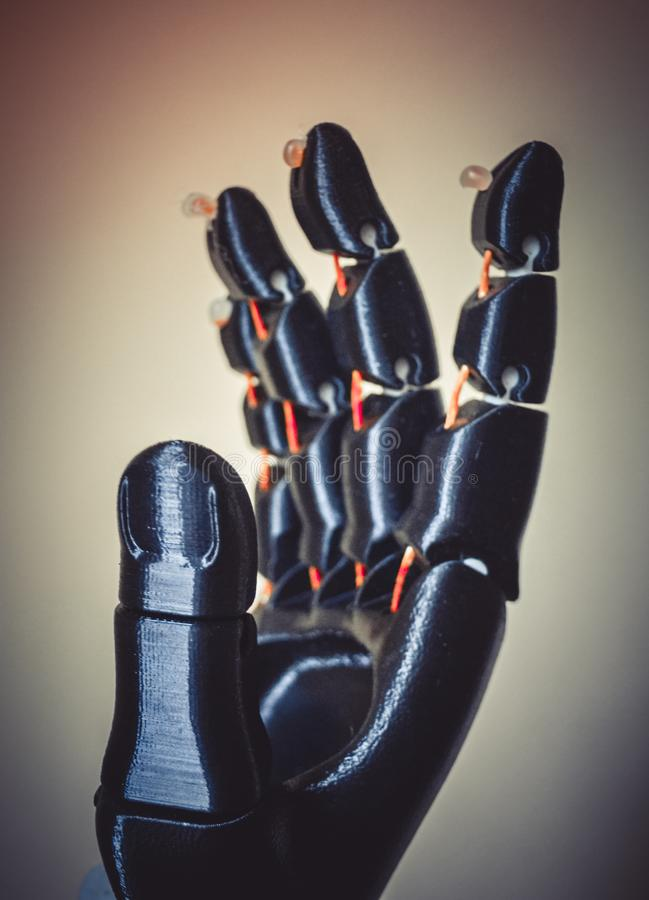 Robot hand fingers from plastic. Close-up. Automatic three dimensional performs plastic modeling. Modern 3D printing technology royalty free stock photos