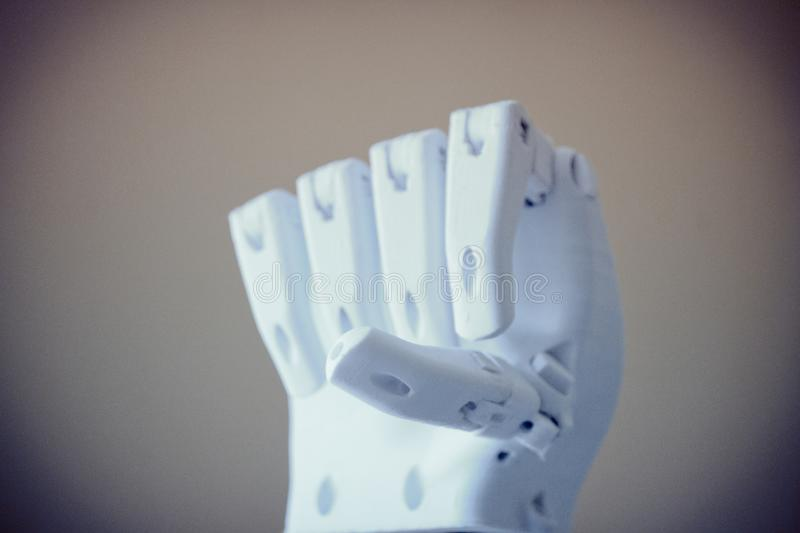 Robot hand fingers from plastic. Close-up conceptual royalty free stock photography