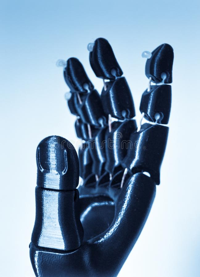 Robot hand fingers from plastic. Close-up. Automatic three dimensional performs plastic modeling. Modern 3D printing technology stock photo