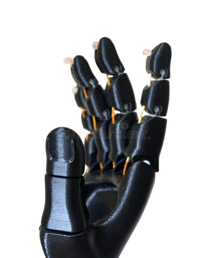 Robot hand fingers from plastic. Isolated on white background. Automatic three dimensional performs plastic modeling. Modern 3D printing technology stock images