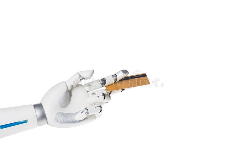 Robot hand holding credit card between fingers. Isolated on white stock photos