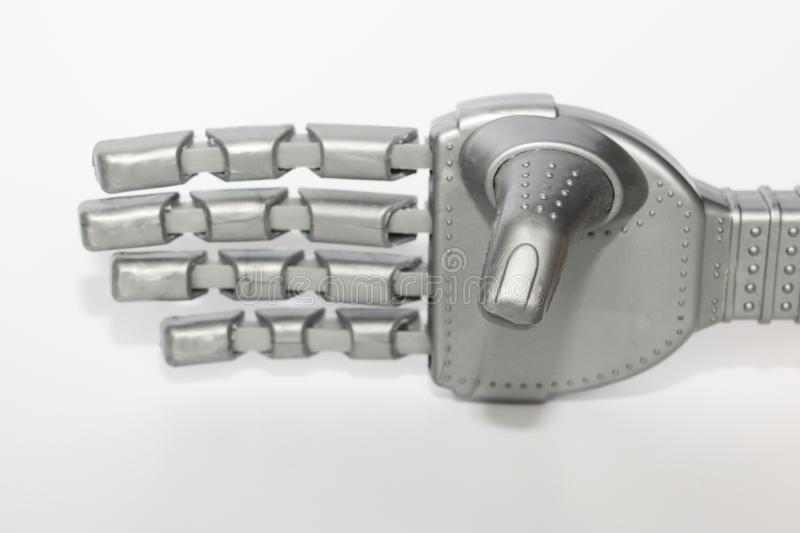 Robot hand. Metal hand cyborg. Close-up. White background. Modern technology and robotics. Robots and people nearby royalty free stock images