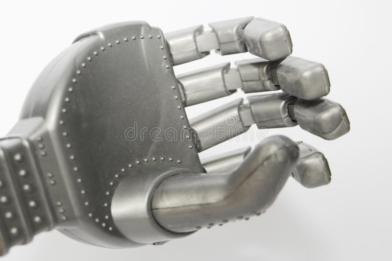 Robot hand. Metal hand cyborg. Close-up. White background. Modern technology and robotics. Robots and people nearby royalty free stock image