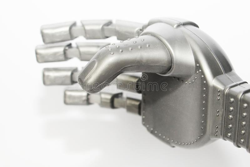 Robot hand. Metal hand cyborg. Close-up. White background. Modern technology and robotics. Robots and people nearby royalty free stock photo