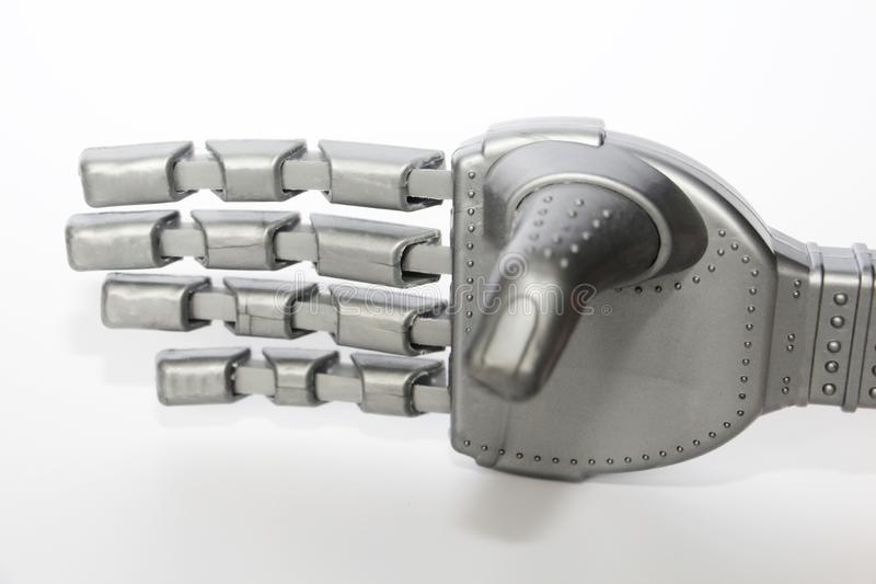 Robot hand. Metal hand cyborg. Close-up. White background. Modern technology and robotics. Robots and people nearby stock images