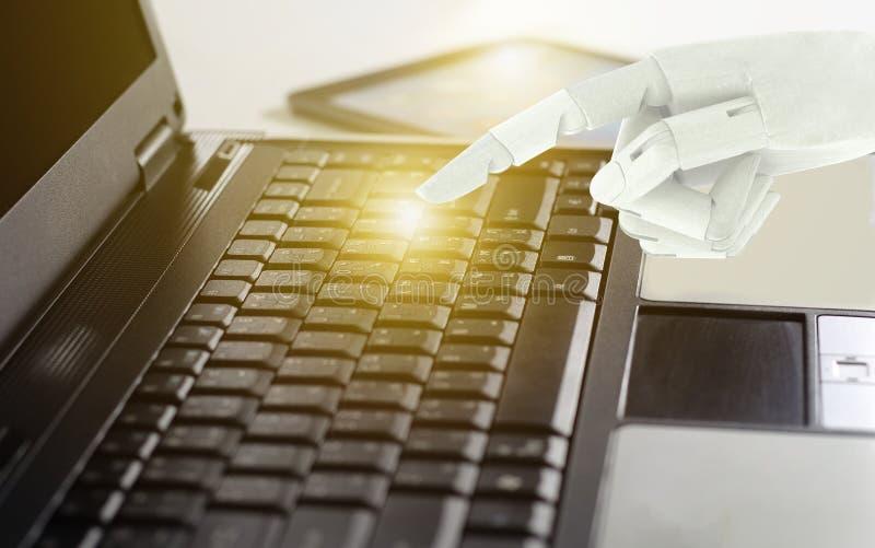 Robot hand use laptop computer, Artificial Intelligence Technology Concept.  stock photos