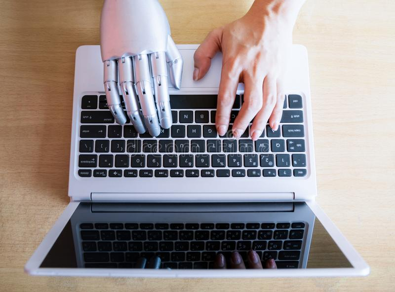 Robot hands and fingers point to laptop button advisor chatbot robotic artificial intelligence stock images