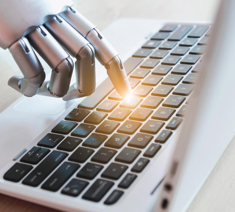 Robot hands and fingers point to laptop button advisor chatbot robotic artificial intelligence concept with light stock photos