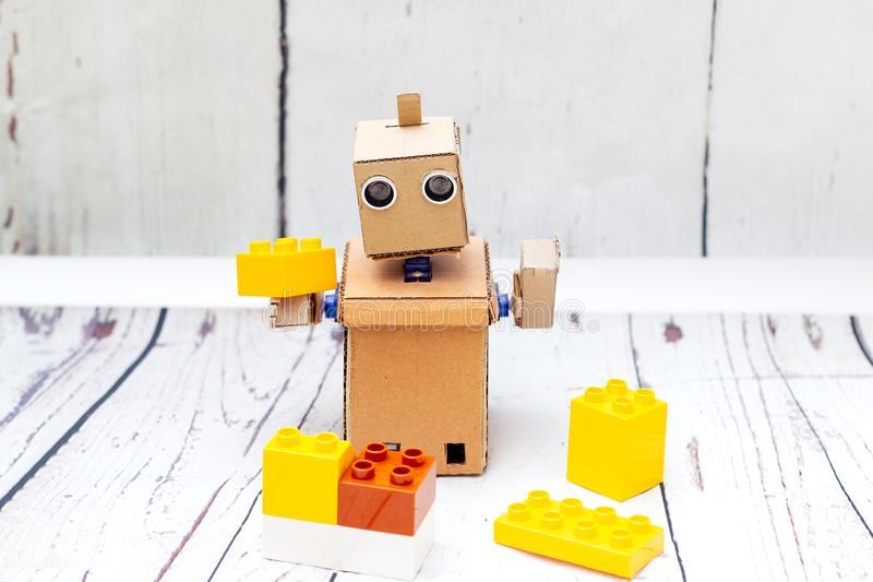 Robot with hands plays constructor. Artificial Intelligence stock photography