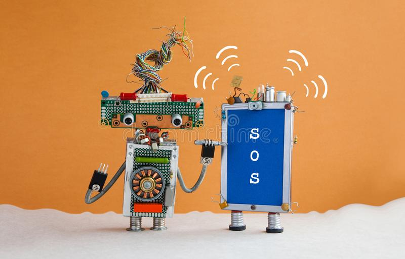 Robot handyman and broken smartphone message SOS. Robot serviceman with a screwdriver wants to fix the phone. Orange royalty free stock photo