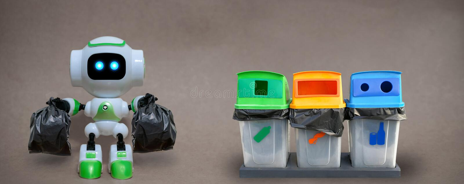 Robot hold garbage bags technology recycle environment on a gray. Background royalty free stock photos