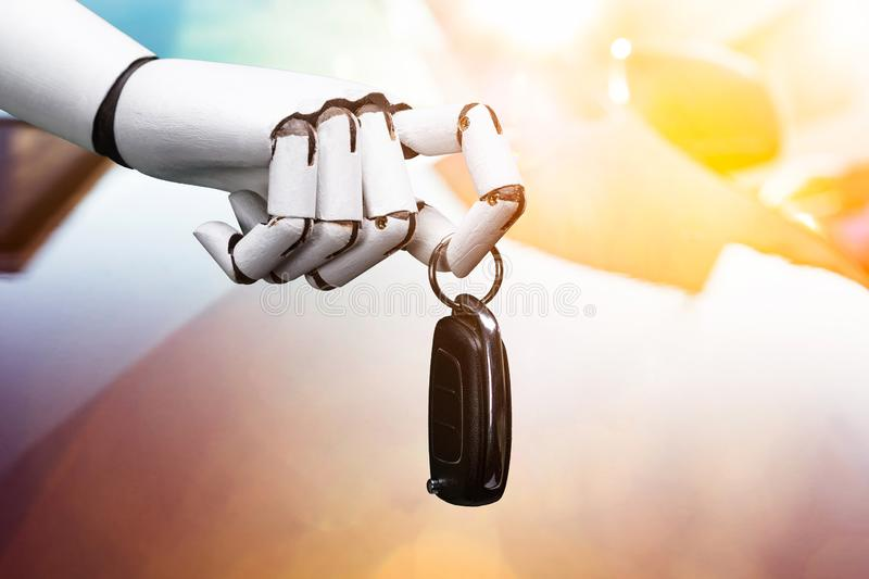 Robot Holding Car Key stock images