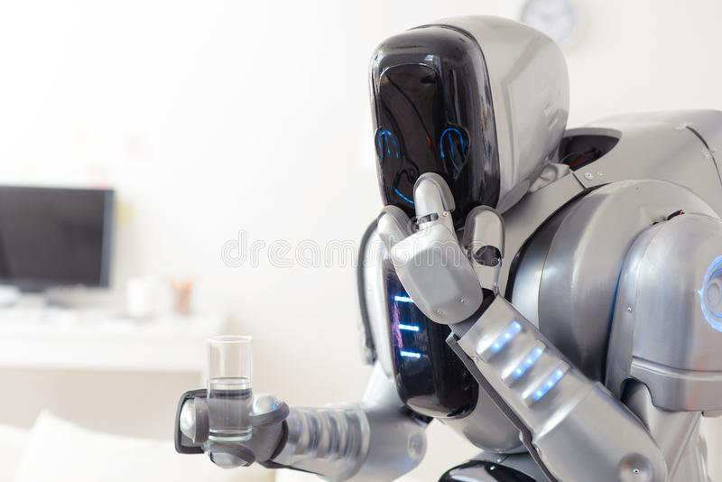 Robot holding glass of water royalty free stock photos