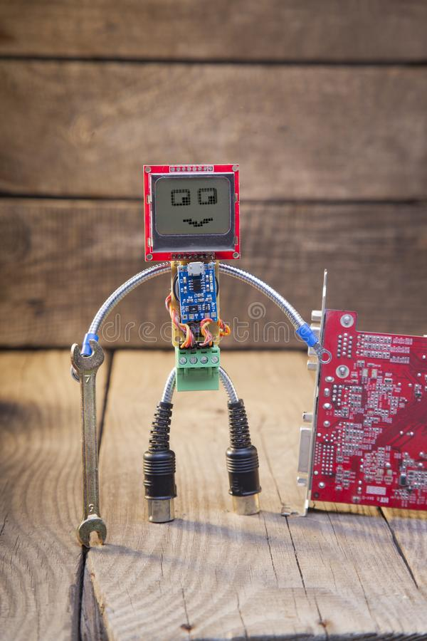 Download Robot Made Of Parts Of Circuit Boards With Wrench, On Wood Backg Stock Photo - Image of blue, computer: 114727148