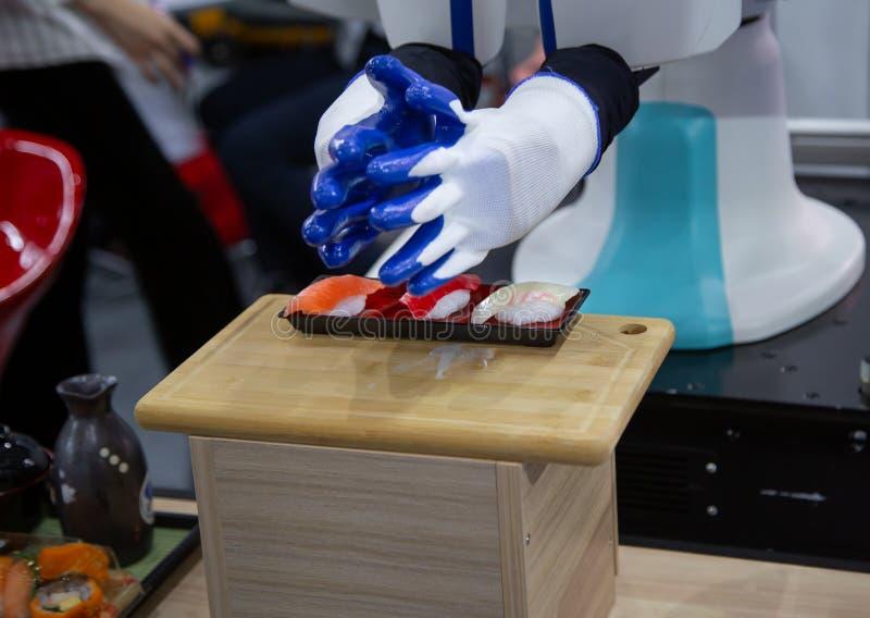 Robot making sushi stock photos