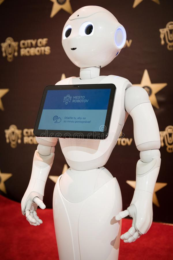 Robot Pepper assistant with information screen royalty free stock photography