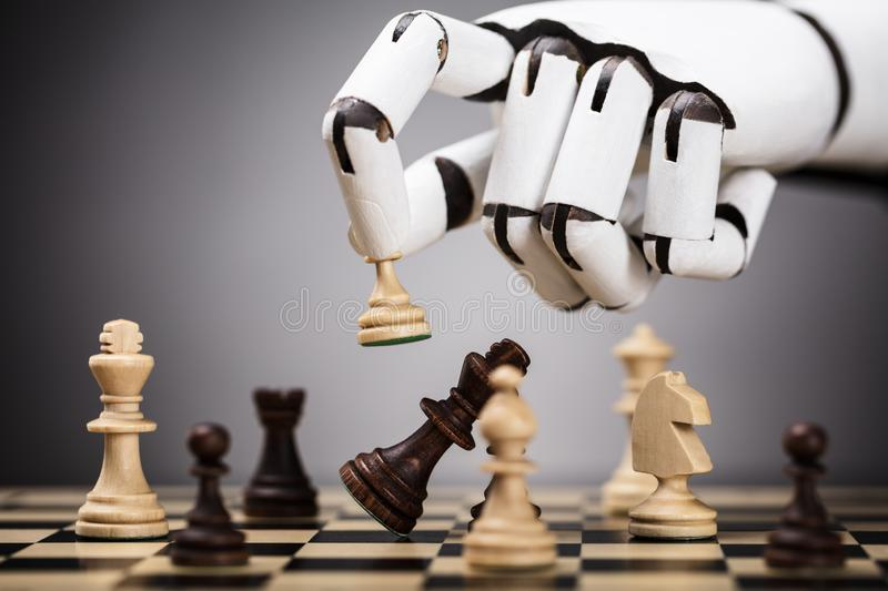 Robot Playing Chess royalty free stock photo