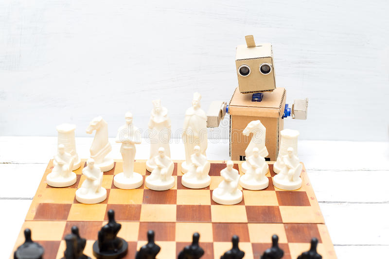 The robot plays a game of chess. Artificial Intelligence. The robot plays a game of chess at home. Artificial Intelligence stock images