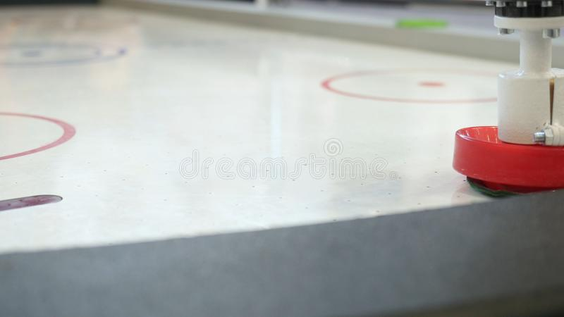 Robot plays with a man in table hockey. Media. High technologies of robots development royalty free stock photo