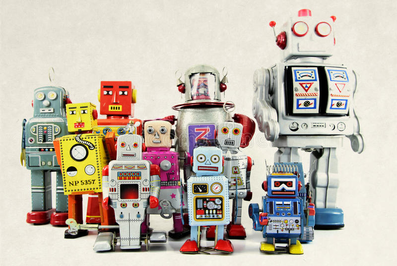 Robot. Retro robot toy group toned image stock photos