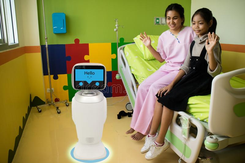 Robot service in medical talk with the patient at patient room i royalty free stock images