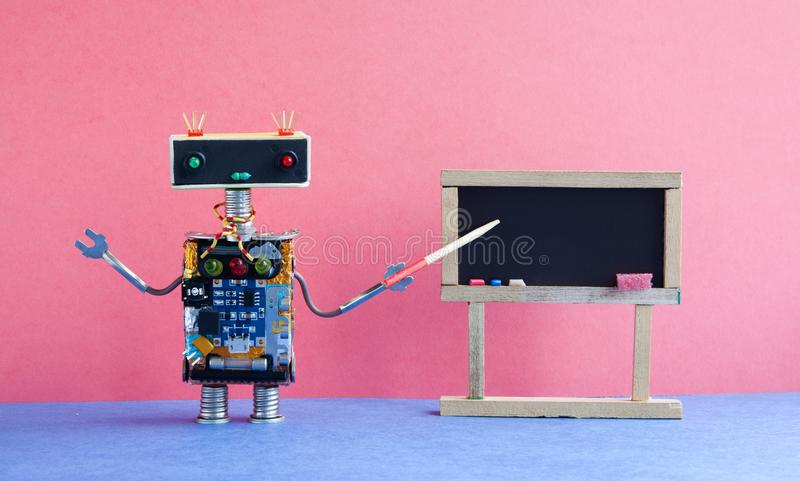 Robot teacher explains modern theory. Classroom interior with empty black chalkboard. Pink blue colorful background royalty free stock image