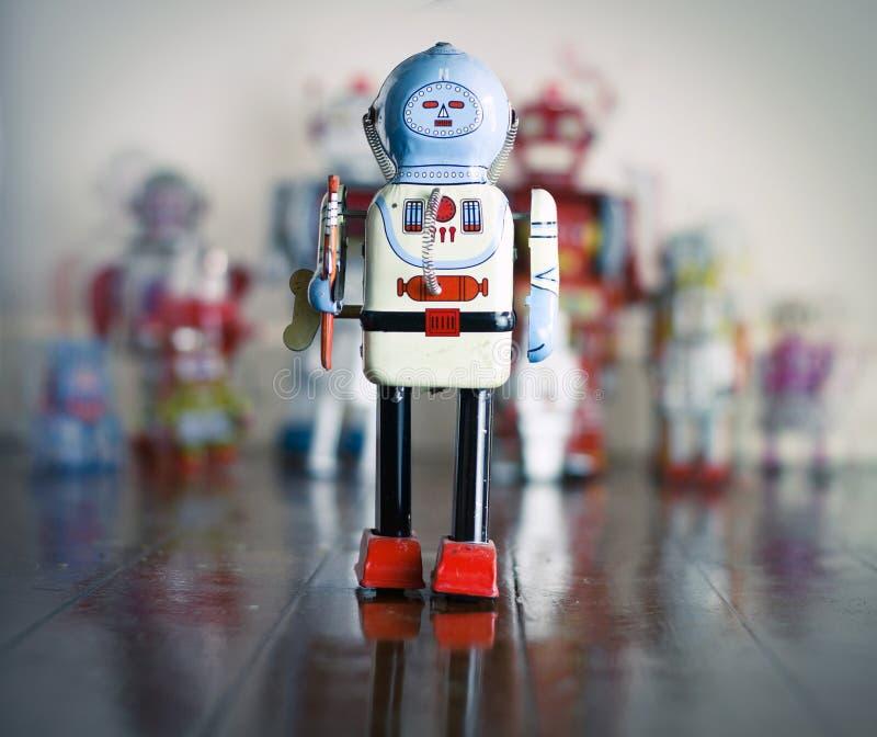 Robot toy. Big robot toy on wooden floor stock photos