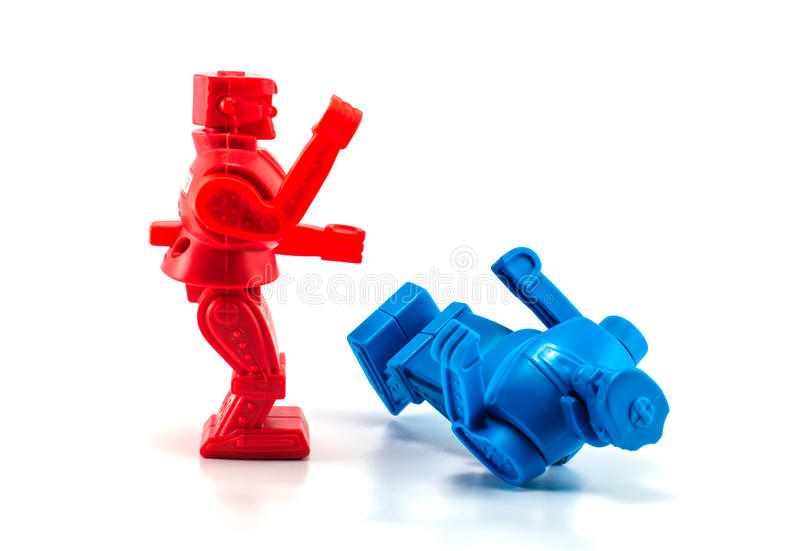 Robot toy knockout. Red robot toy knockout blue robot stock image