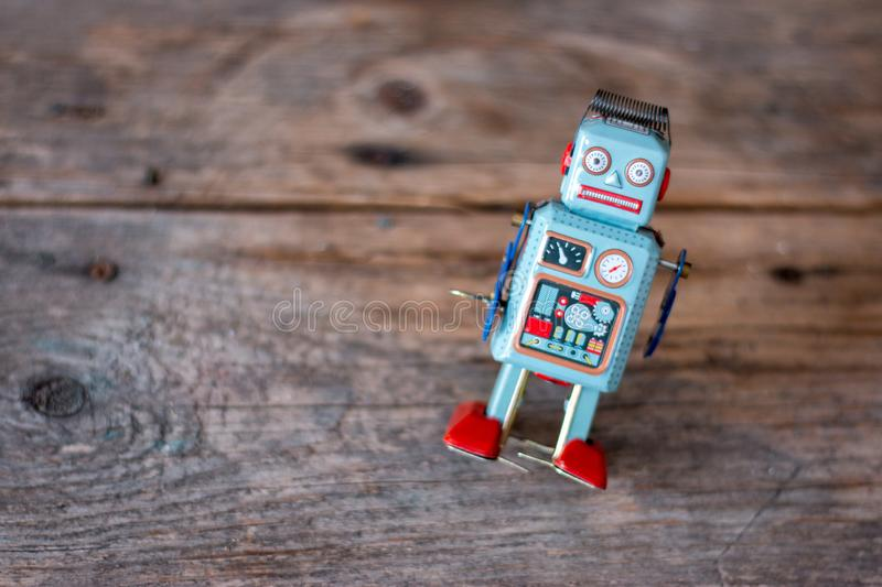 Robot toy, symbol for a chatbot or social bot and algorithms. Wood texture. Artificial intelligence ai data big computer future internet politics twitter royalty free stock photo