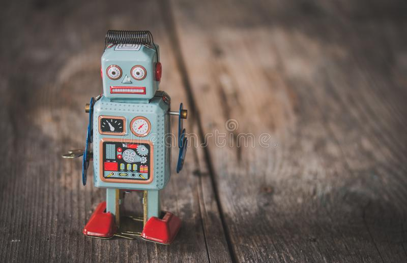 Robot toy, symbol for a chatbot or social bot and algorithms. Wood texture. Artificial intelligence ai data big computer future internet politics twitter royalty free stock photography
